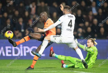 Besiktas' goalkeeper Loris Karius (R) and Victor Torre (C) in action against Basaksehir's Demba Ba (L) at the Turkish Super League match between Basaksehir and Besiktas in Istanbul, Turkey, 14 February 2020.