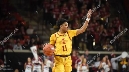 Iowa St guard Prentiss Nixon pushes down the court during the first half of an NCAA college basketball game against Oklahoma in Norman, Okla