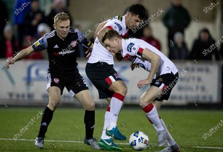 Dundalk vs Derry City. Dundalk's Patrick Hoban and Daniel Kelly with Conor McCormack of Derry City