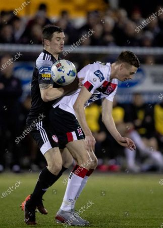 Dundalk vs Derry City. Dundalk's Daniel Kelly with Ciaron Harkin of Derry City