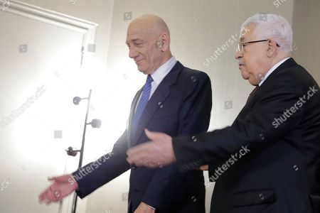 Stock Image of Palestinian President Mahmoud Abbas, right, and former Israeli Prime Minister Ehud Olmert arrive for a news conference in New York