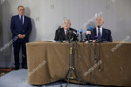 Stock Photo of Palestinian President Mahmoud Abbas, center, and former Israeli Prime Minister Ehud Olmert, right, speak during a news conference in New York