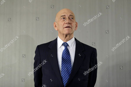 Former Israeli Prime Minister Ehud Olmert takes questions from reporters after a news conference in New York
