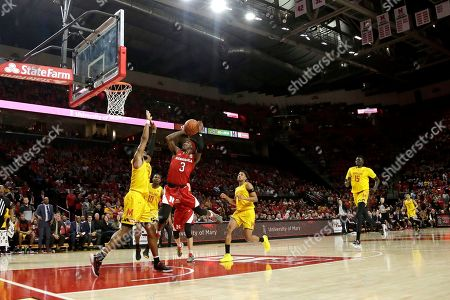 Nebraska guard Cam Mack (3) goes up for a shot against Maryland forward Donta Scott (24) during the first half of an NCAA college basketball game, in College Park, Md