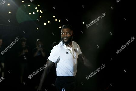 Stock Photo of Togo striker Emmanuel Adebayor smiles during his presentation as the newest member of Paraguay's Olimpia soccer team, at the Manuel Ferreira stadium in Asuncion, Paraguay