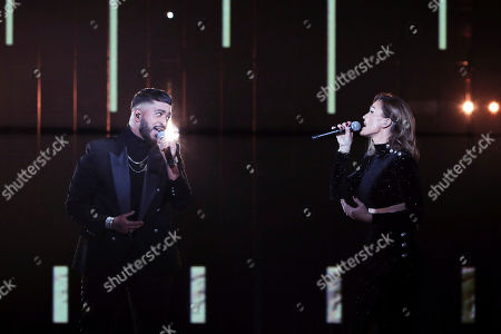 Stock Picture of French singers Charlotte Gonin aka Vitaa, right, and Slimane Nebchi aka Slimane perform on stage during the 35th Victoires de la Musique, the annual French music awards ceremony, in Paris