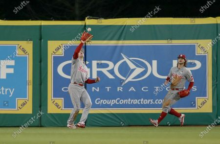 Indiana center fielder Grant Richardson (6) camps under a fly ball as teammate Ethan Vecrumba (7) backs him up during NCAA Baseball action between the Indiana Hoosiers and the LSU Tigers at the Alex Box Stadium, Skip Bertman Field in Baton Rouge, LA