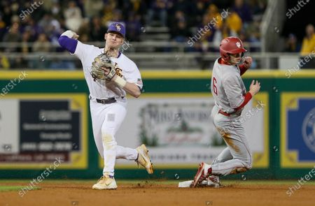 LSU second baseman Cade Doughty (4) makes a throw to first base past a sliding Grant Richardson (6) for Indiana during NCAA Baseball action between the Indiana Hoosiers and the LSU Tigers at the Alex Box Stadium, Skip Bertman Field in Baton Rouge, LA