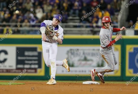 Stock Picture of LSU second baseman Cade Doughty (4) makes a throw to first base past a sliding Grant Richardson (6) for Indiana during NCAA Baseball action between the Indiana Hoosiers and the LSU Tigers at the Alex Box Stadium, Skip Bertman Field in Baton Rouge, LA