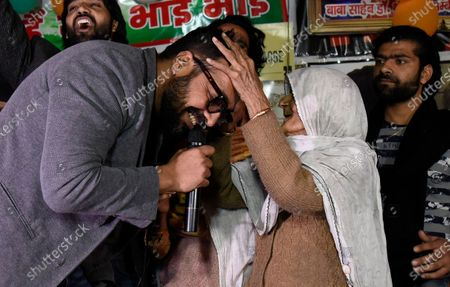 Bollywood director Anurag Kashyap takes blessings from an elderly woman during the ongoing protests against CAA, NRC and NPR