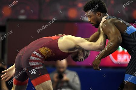 Murad Kuramagomedov of Hungary (in red) and Frank Chamizo Marquez of Italy fight in the semifinal round of the men's freestyle 74kg weight category of the European Wrestling Championships in Rome, Italy, 15 February 2020.