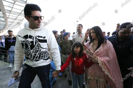 Bollywood actor Abhishek Bachchan (L) with his wife and Bollywood actress Aishwarya Rai Bachchan   at Raja Bhoj airport in Bhopal, India, 15 February 2020. The couple was  on a personal visit to city
