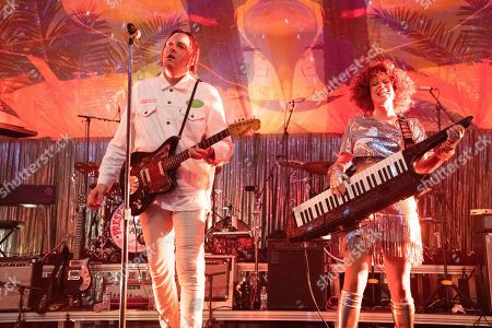 Stock Image of Win Butler, Regine Chassagne. Win Butler, left, and Regine Chassagne of Arcade Fire perform at the Krewe du Kanaval Mardi Gras Ball at Mahalia Jackson Theater for the Performing Arts, in New Orleans