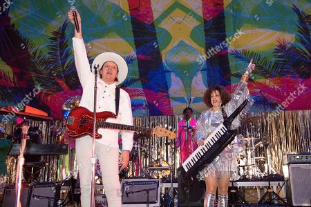 Win Butler, Regine Chassagne. Win Butler, left, and Regine Chassagne of Arcade Fire perform at the Krewe du Kanaval Mardi Gras Ball at Mahalia Jackson Theater for the Performing Arts, in New Orleans