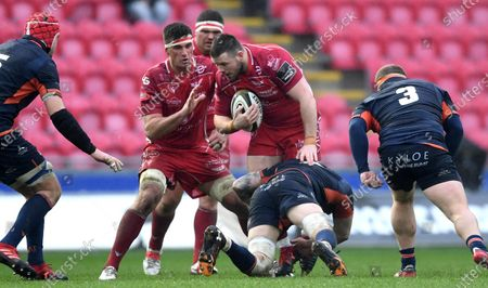 Rob Evans of Scarlets is stopped.