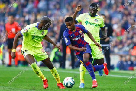 FC Barcelona's striker Ansu Fati (C) in action against Getafe's defenders Oghenekaro Etebo (R) and Allan Nyom (L) during the Spanish LaLiga soccer match between FC Barcelona and Getafe SAD at Camp Nou stadium in Barcelona, Catalonia, Spain, 15 February 2020.