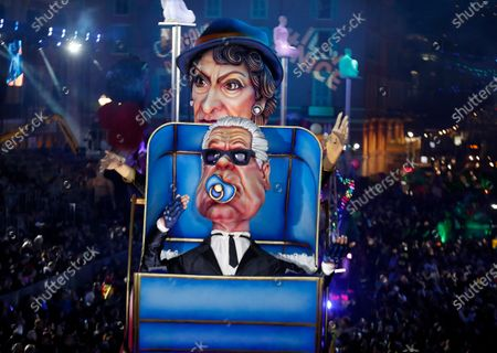 Stock Photo of A float of French designer Coco Chanel and late German designer Karl Lagerfeld makes its way through the crowd during the 136th annual Carnival parade, in Nice, France, 15 February 2020. The carnival runs from 15 to 29 February 2020, under the main theme 'King of Fashion'.