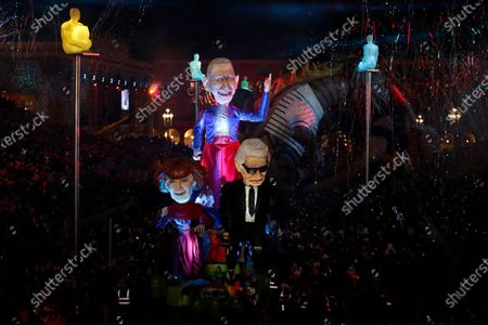 A float of French fashion designer Sonia Rykiel, French designer Jean-Paul Gaultier and late German designer Karl Lagerfeld makes its way through the crowd during the 136th annual Carnival parade, in Nice, France, 15 February 2020. The carnival runs from 15 to 29 February 2020, under the main theme 'King of Fashion'.