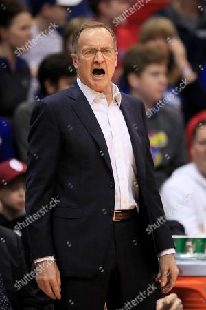 Oklahoma head coach Lon Kruger yells to his team during the first half of an NCAA college basketball game against Kansas in Lawrence, Kan