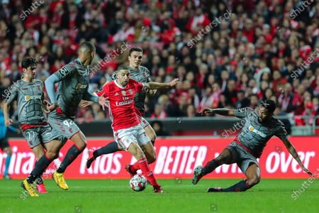 Benfica`s Adel Taarabt (C) fights for the ball with Wallace (R) of Sporting de Braga during their Portuguese First League soccer match held at Luz Stadium, Lisbon, Portugal, 15th February 2020.