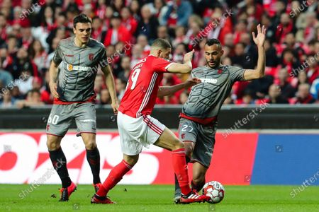 Benfica`s Adel Taarabt (C) fights for the ball with Joao Palhinha (L) and Fransergio of Sporting de Braga during their Portuguese First League soccer match held at Luz Stadium, Lisbon, Portugal, 15th February 2020.
