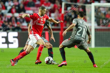 Benfica`s Adel Taarabt (L) fights for the ball with Ricardo Horta of Sporting de Braga during their Portuguese First League soccer match held at Luz Stadium, Lisbon, Portugal, 15th February 2020.