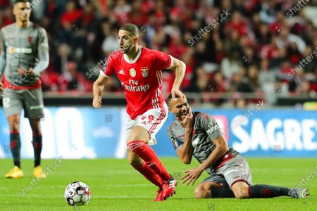Benfica`s Adel Taarabt (L) fights for the ball with  Fransergio of Sporting de Braga during their Portuguese First League soccer match held at Luz Stadium, Lisbon, Portugal, 15th February 2020.