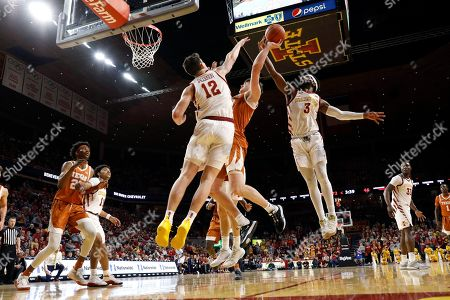 Michael Jacobson, Tre Jackson, Will Baker. Texas center Will Baker drives to the basket between Iowa State's Michael Jacobson (12) and Tre Jackson (3) during the second half of an NCAA college basketball game, in Ames, Iowa. Iowa State won 81-52