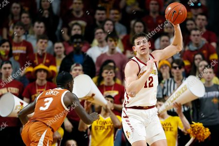 Michael Jacobson, Courtney Ramey. Iowa State forward Michael Jacobson catches a pass over Texas guard Courtney Ramey, left, during the second half of an NCAA college basketball game, in Ames, Iowa