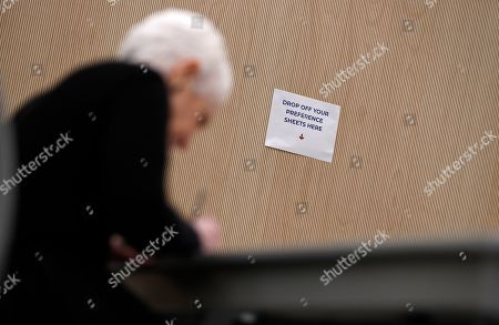 A sign advertises where to drop you ballot as Landra Reid, wife of former U.S. Sen. Harry Reid, fills out her ballot at an early voting site at the East Las Vegas library, in Las Vegas