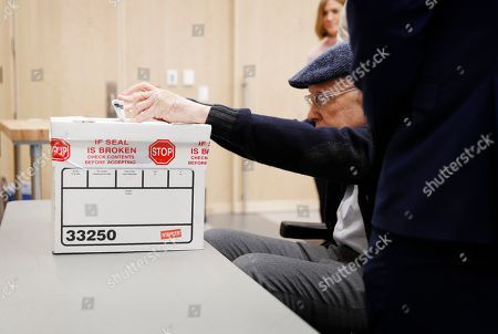 Former U.S. Sen. Harry Reid casts his ballot at an early voting site at the East Las Vegas library, in Las Vegas