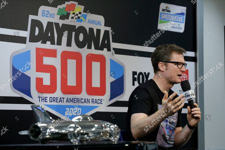 Dale Earnhardt Jr., team owner and TV analyst answers questions during a news conference before the NASCAR Daytona 500 auto race at Daytona International Speedway, in Daytona Beach, Fla