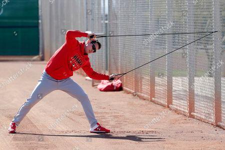 Cincinnati Reds baseball player Matt Bowman stretches during the teams' first spring training practice, in Goodyear, Ariz