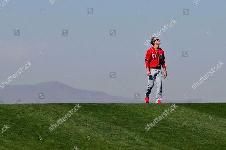 Cincinnati Reds baseball player Matt Bowman runs hill sprints during the teams' first spring training practice, in Goodyear, Ariz