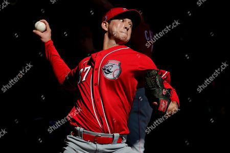 Stock Photo of Cincinnati Reds baseball player Matt Bowman (67) throws during the teams' first spring training workout, in Goodyear, Ariz