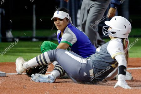 Stock Image of Tiare Lee, Jessica Williams. Texas A&M Corpus Christi's Tiare Lee, left, makes the tag at third base for the out against Louisiana Monroe's Jessica Williams, right, during an NCAA softball game, in Conroe, Texas