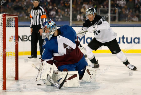 R m. Colorado Avalanche goaltender Philipp Grubauer, front, stops a shot by Los Angeles Kings right wing Tyler Toffoli during the first period of an NHL hockey game, at Air Force Academy, Colo