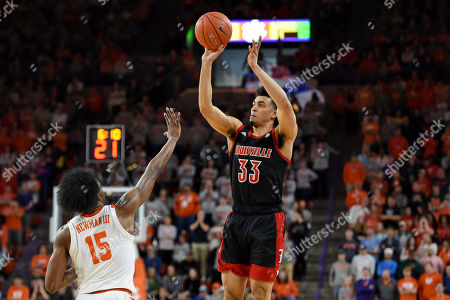 Louisville's Jordan Nwora (33) shoots a jump shot while defended by Clemson's John Newman lll during the first half of an NCAA college basketball game, in Clemson, S.C