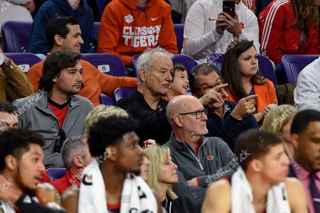 Stock Photo of Actor Bill Murray, center, points while watching the first half of an NCAA college basketball game between Clemson and Louisville, in Clemson, S.C