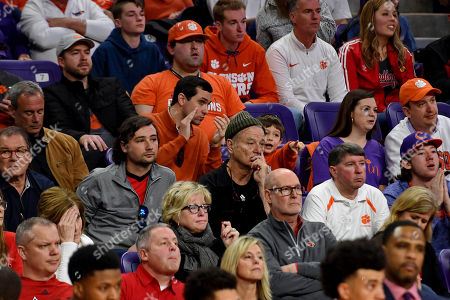 Actor Bill Murray, center wearing beanie, and his son Jackson William Murray, left, watch the action during the final minutes of an NCAA college basketball game between Clemson and Louisville, in Clemson, S.C. Clemson defeated Louisville 77-62