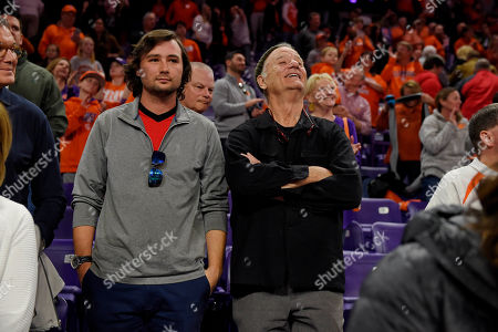 Actor Bill Murray, right, and his son Jackson William Murray, left, watch during the second half of an NCAA college basketball game between Clemson and Louisville, in Clemson, S.C