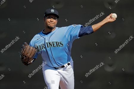 Stock Image of Seattle Mariners pitcher Aaron Fletcher throws during spring training baseball practice, in Peoria, Ariz