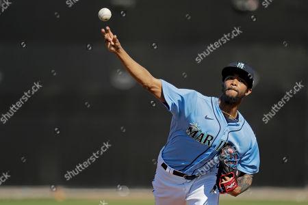 Seattle Mariners pitcher Carl Edwards Jr. throws during spring training baseball practice, in Peoria, Ariz