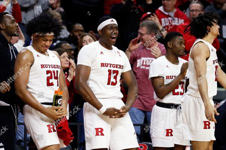 Rutgers guard Ron Harper Jr. (24) and forward Shaq Carter (13) celebrate on the bench during the second half of an NCAA college basketball game against Illinois, in Piscataway, N.J. Rutgers won 72-57