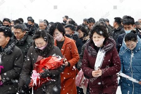 People visit statues of their late leaders Kim Il Sung and Kim Jong Il to lay flowers on Mansu Hill in Pyongyang, North Korea, Sunday, Feb.16, 2020, to commemorate the 78th birthday of Kim Jong Il