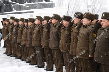 Korean People's Internal Security Forces (KPISF) service personnel salute at statues of their late leaders Kim Il Sung and Kim Jong Il on Mansu Hill in Pyongyang, North Korea, Sunday, Feb.16, 2020, to commemorate the 78th birthday of Kim Jong Il