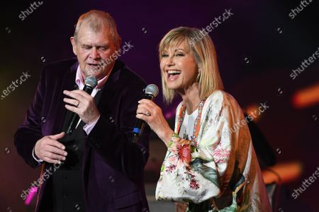John Farnham (left) and Olivia Newton-John perform during the Fire Fight Australia bushfire relief concert at ANZ Stadium in Sydney, Australia,  16 February 2020. Thousands of people attended the concert, with 10 hours of musical performances, to raise funds for communities devastated by bushfires.