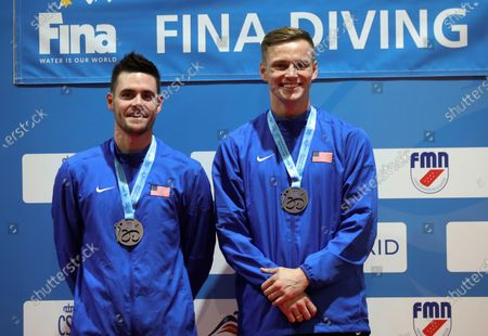 US divers David Boudia (L) and Steele Jhonson (R) second placed celebrate on the podium after the men's 3 meters synchronized dive finals in the framework of the FINA Diving Grand Prix Madrid 2020 at M86 swimming pools in Madrid, Spain, 16 February 2020.