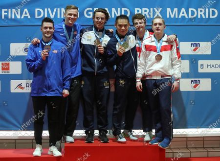 Stock Picture of (L-R) second placed US divers David Boudia and Steele Jhonson, first placed Shixin Li y Matthew Carter of Australia and third placed Artem Trubin y Gennadii Vagin of Russia celebrate on the podium after the men's 3 meters synchronized dive finals in the framework of the FINA Diving Grand Prix Madrid 2020 at M86 swimming pools in Madrid, Spain, 16 February 2020.