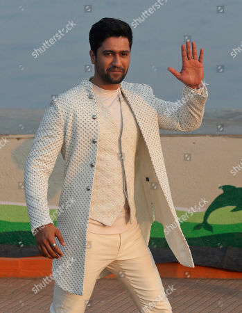 Stock Image of Bollywood actor Vicky Kaushal displays creations by Kunal Rawal during Lakme Fashion Week in Mumbai, India, Sunday, Feb.16, 2020